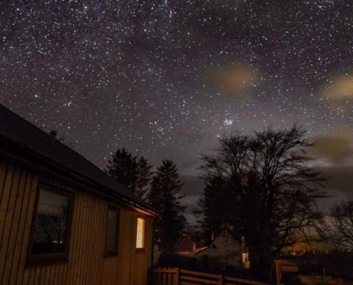 Holiday Cottage under Dark Skies